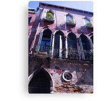 Venice windows overlooking canal below Canvas Print