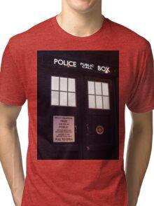 Travel in time through the TARDIS Doors.... Tri-blend T-Shirt