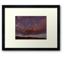 skull w/ some clouds behind Framed Print