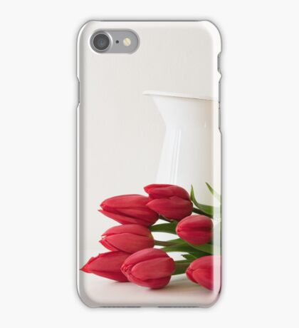 Red tulips next to white jug iPhone Case/Skin