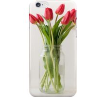 Red tulips in tall glass jar iPhone Case/Skin
