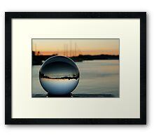 Crystal ball with sunset and boats Framed Print