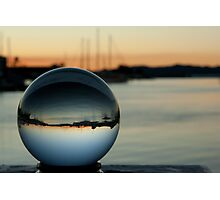 Crystal ball with sunset and boats Photographic Print