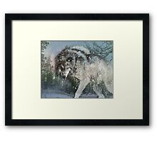 Wolf in the snow Framed Print