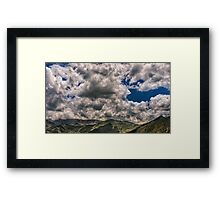 Tibet, blue sky dramatic clouds and mountains Framed Print