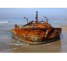 Rusty abandoned beached ship  Photographic Print