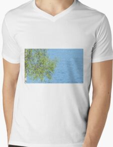 birch bunch of leaves the lake in the background T-Shirt