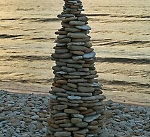 Stone Pyramid on the Shore at Sunset by Irina777