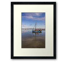 Boat on the waterfront Framed Print