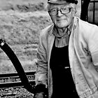 Engineer on the Woody Bay Steam Train by Photography  by Mathilde