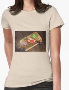 Freshly cut vegetables on a cutting board with a chef's knife  Womens Fitted T-Shirt
