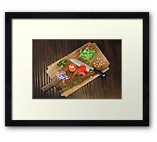 Freshly cut vegetables on a cutting board with a chef's knife  Framed Print