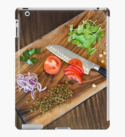 Freshly cut vegetables on a cutting board with a chef's knife  iPad Case/Skin