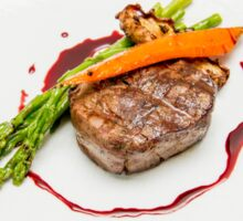 Fillet Steak medallion with vegetables on a plate  Sticker