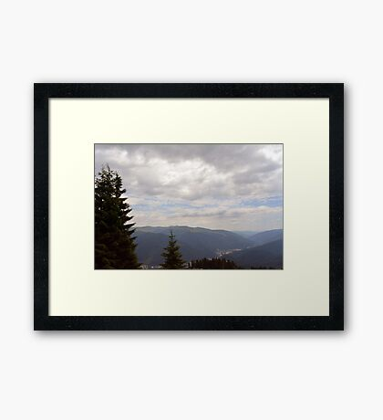 Natural scenery with mountains and cloudy sky. Framed Print