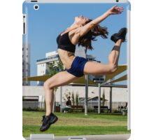 Young female bodybuilder exercises outdoors in a park iPad Case/Skin