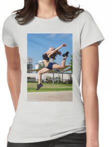 Young female bodybuilder exercises outdoors in a park Womens Fitted T-Shirt