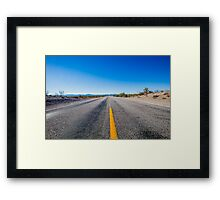 Straight endless road Through Desert Framed Print