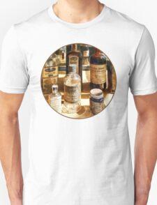 Medicine Bottles in Glass Case Unisex T-Shirt