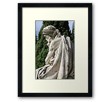 Statue of a young grieving man at the Monumental Cemetery of Staglieno (Cimitero monumentale di Staglieno), Genoa, Italy Framed Print