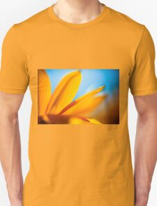 Extreme close up of a yellow daisy with a blue sky background  Unisex T-Shirt