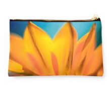 Extreme close up of a yellow daisy with a blue sky background  Studio Pouch