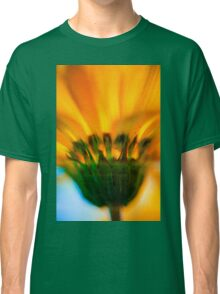 Extreme close up of a yellow daisy with a blue sky background  Classic T-Shirt