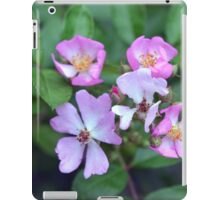 Small purple flowers on green leaves background. iPad Case/Skin