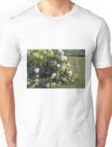 Bush of white flowers in the garden. Unisex T-Shirt