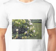 Bush of white flowers in the garden. Unisex T-Shirt