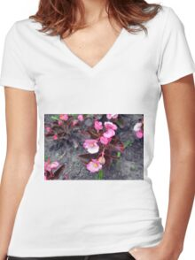 Beautiful fragile pink flowers on the ground. Women's Fitted V-Neck T-Shirt