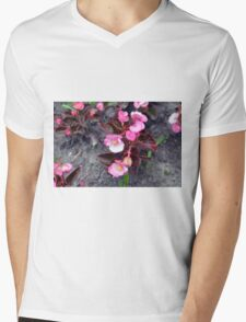 Beautiful fragile pink flowers on the ground. Mens V-Neck T-Shirt