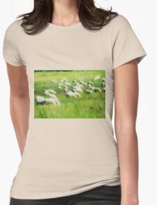 soft focus A flock of sheep graze in a green meadow  Womens Fitted T-Shirt