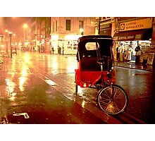 A rickshaw in the rain on Old Compton Street (Soho, London) Photographic Print