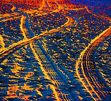 Tire Tracks and Sunset at the Beach by Gilda Axelrod