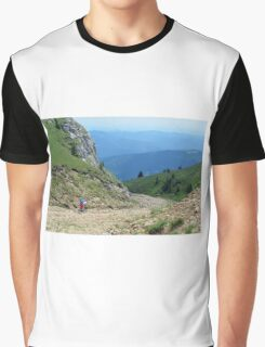 Natural scenery with mountain view, cloudy sky and biker man. Graphic T-Shirt