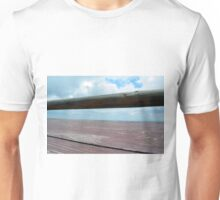 Detail of wooden table against the sky. Unisex T-Shirt