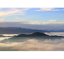 Mountain peak surrounded by morning mist Photographic Print