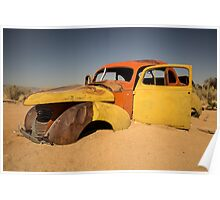 Abandoned car in the desert Poster