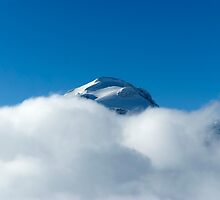 Grande Motte Summit Tignes above the clouds by Clayton Suares