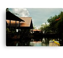 Riding up the river Canvas Print