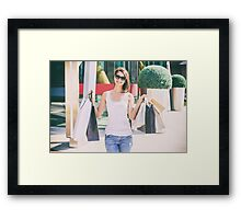 Happy Young Woman Holding Shopping Bags Framed Print