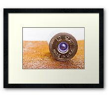 Close up of a 12ga shotgun shell with shallow DOF. Framed Print