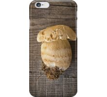 Mushroom Boletus over Wooden Background iPhone Case/Skin