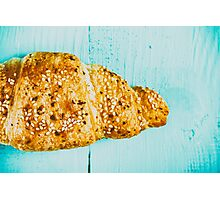 Croissant On Blue Table Photographic Print