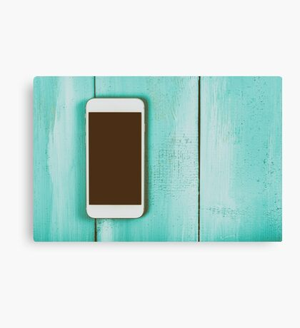 White Mobile Phone With Blank Screen On Wood Table Canvas Print