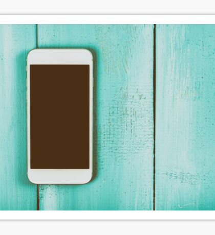 White Mobile Phone With Blank Screen On Wood Table Sticker