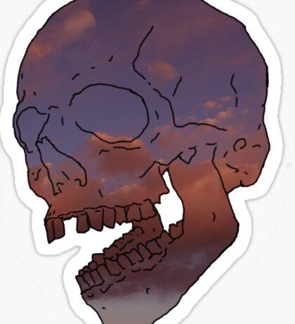 skull w/ some clouds behind Sticker
