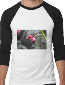 Small red flower bud, natural background. Men's Baseball ¾ T-Shirt
