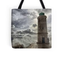 Lighthouse in the storm Tote Bag
